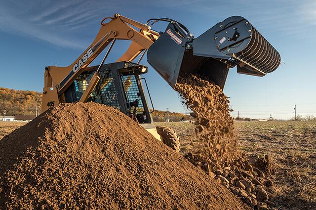 Clod-Buster dumping dirt