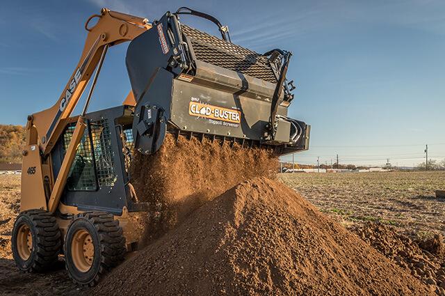 Clod-Buster sifting topsoil